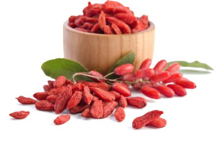 barbary: berberries near goji berries heap and bowl with goji isolated on white background