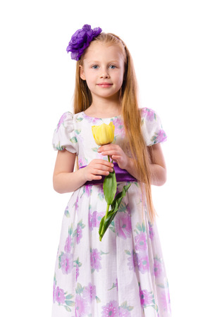 many babies: Little girl holding tulip isolated on white