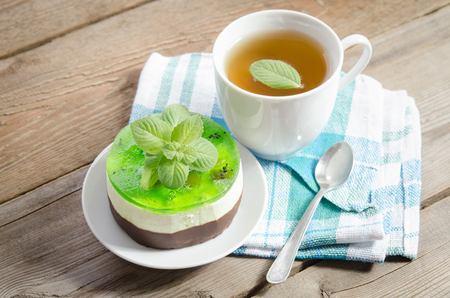 horizontal position: herbal tea with cake on wooden background. horizontal position Stock Photo