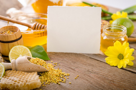 Beekeeping products on a wooden table with empty card for you text . side view Stock Photo