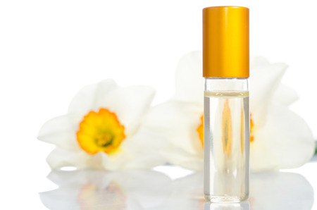 perfume bottle with flowers isolated on white