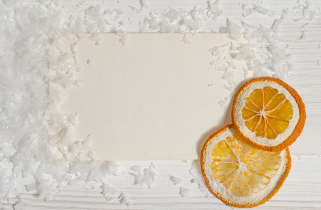 Christmas card with snow and dry oranges Stock Photo