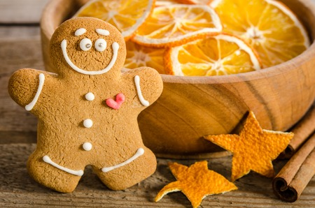 Christmas decoration with oranges and gingerbread on wooden background Stock Photo