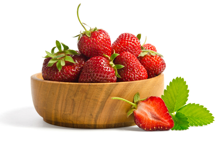 Red sweet strawberries in plate on white background
