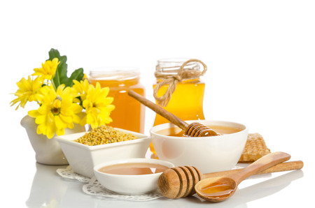 Yellow flowers and bee products (honey, pollen) isolated on white background