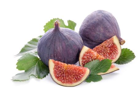 owoce drzewa figowego (całość i część) z liśćmi na białym tle Zdjęcie Seryjne
