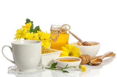A cup of tea and bee products (honey, pollen) isolated on white background