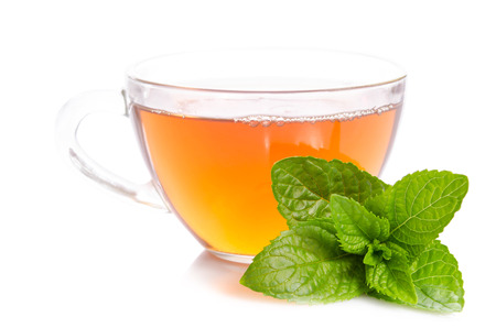 Glass cup of Tea with mint leaves   isolated on white background Imagens