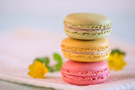 tower from colorful macarons on towel with nice yellow flower