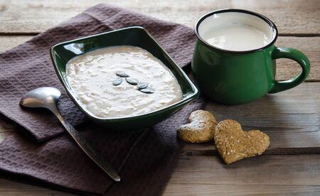 Healthy breakfast. Sesame dry cookies in the form of heart porridge of amaranth with pumpkin seeds and yogurt.