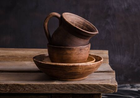 clay dishes on an old wooden table