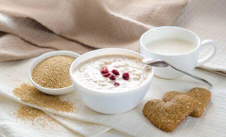 Sesame dry cookies in the form of heart, amaranth and yogurt, healthy breakfast
