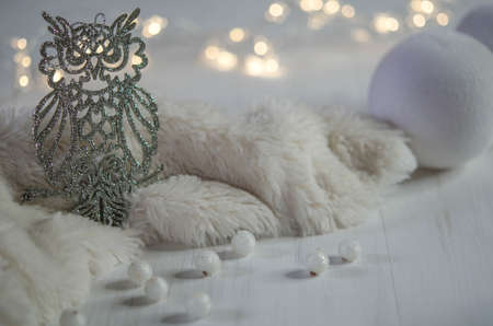 Owl and white balloons on the table. Christmas decorations