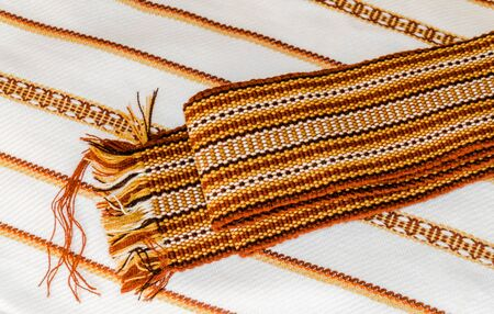 Ukrainian towels embroidered with the national orange-brown ethnic ornament photo