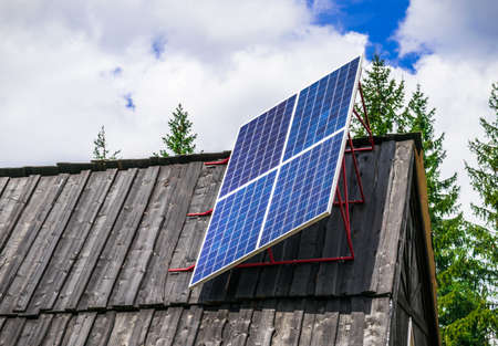 dishonest: A solar panel in a remote mountain village on the roof Stock Photo