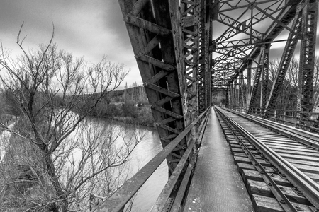 train iron bridge over the river spain duero black & white
