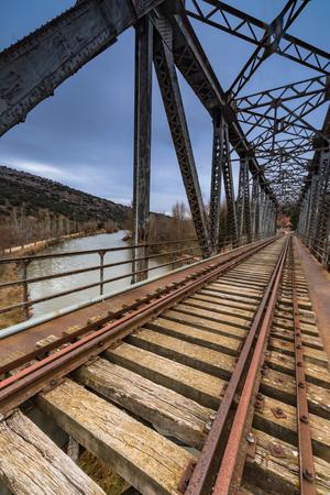train iron bridge over the river spain duero