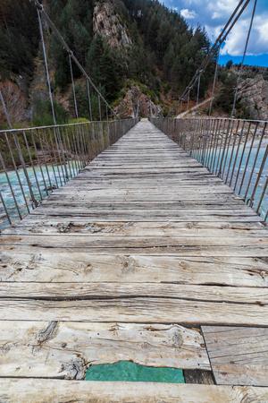 suspension bridge over the wild river in spain