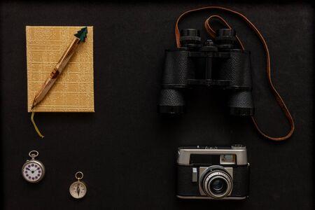 camera prismatic compass watch notebook