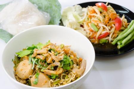 Thai noodle and spicy papaya salad somtum  Stock Photo