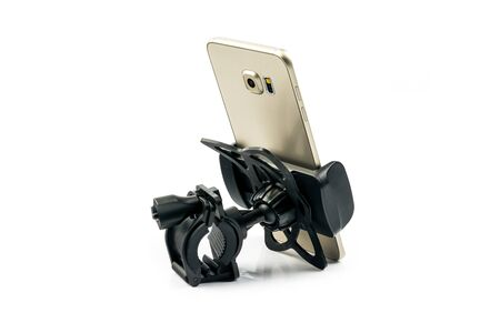 Back side view of new universal phone holder for car motorbike and bike with installed gold smartphone. Isolated on white background