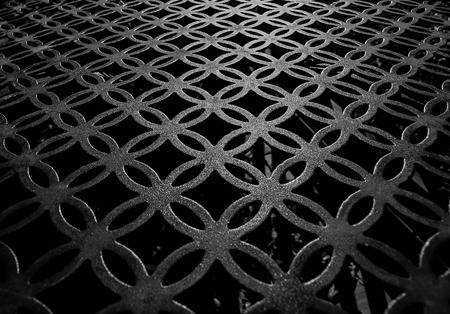 table surface: Iron table black and white close-up Stock Photo