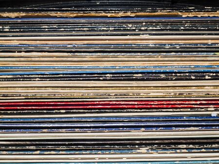 cover art: A stack or vinyl records