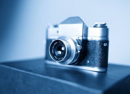 rangefinder: Diagonal vintage blue rangefinder camera background