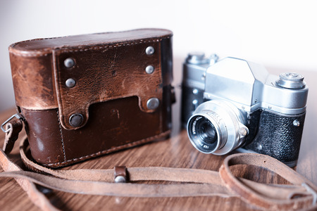 rangefinder: Vintage rangefinder camera with leather cover case background