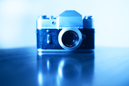 rangefinder: Horizontal vintage blue rangefinder camera background Stock Photo