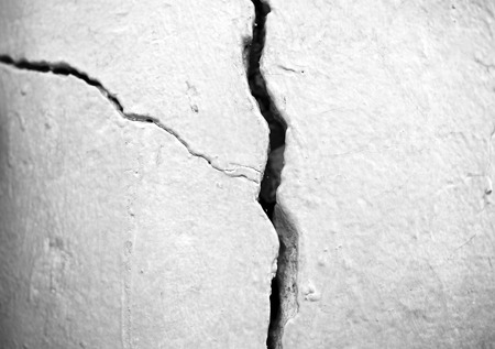 Vertical black and white crack in wall background Stock Photo