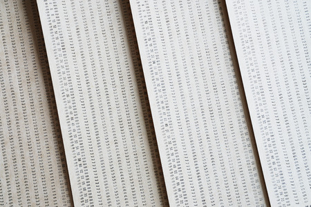 punched: Diagonal vintage punched card textured background Stock Photo