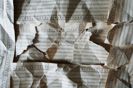 punched: Horizontal crumpled punched cards composition