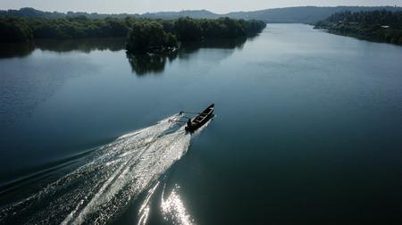 boatman: Indian boatman driving lake floating