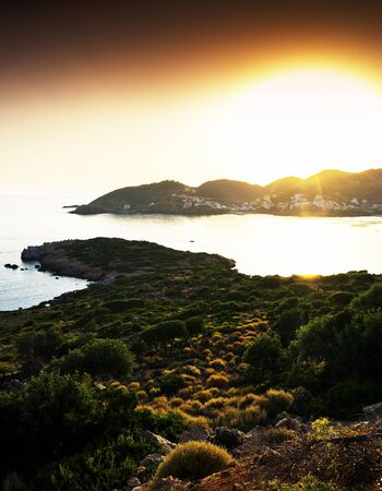 Horizontal vivid Crete island sunset landscape background backdrop Stock Photo