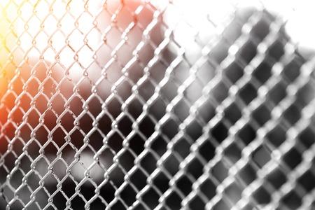 Horizontal prison fence with light leak bokeh background Stock Photo