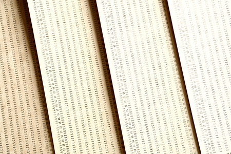 punched: Diagonal vintage yellow punched card textured background