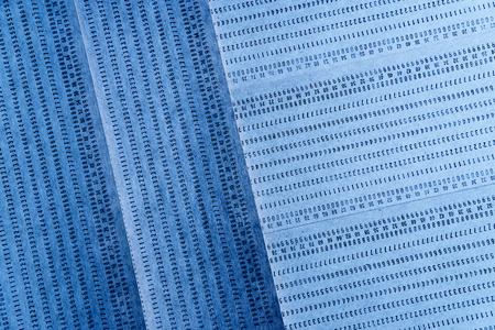 punched: Diagonal vintage blue punched card textured background