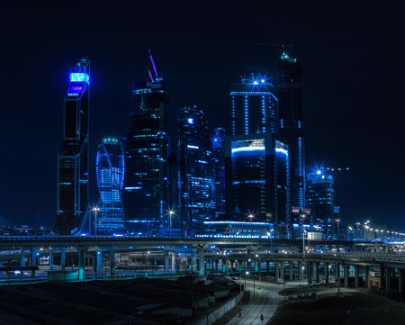 Horizontal vivid blue night Moscow city business center background backdrop
