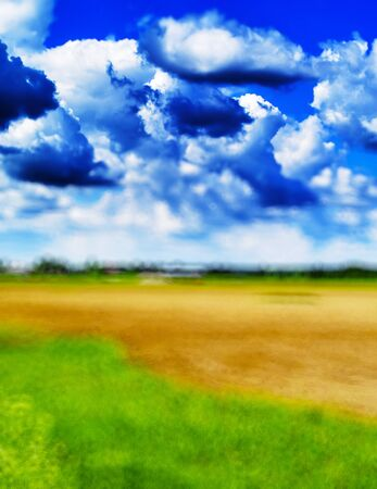 Vertical blurred abstract landscape with real clouds background