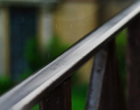 handrails: Horizontal balcony handrails under rain super detailed closeup abstraction bokeh background backdrop Stock Photo