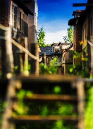 western town: Vertical vintage wild west western town blurred bokeh decoration background backdrop Stock Photo