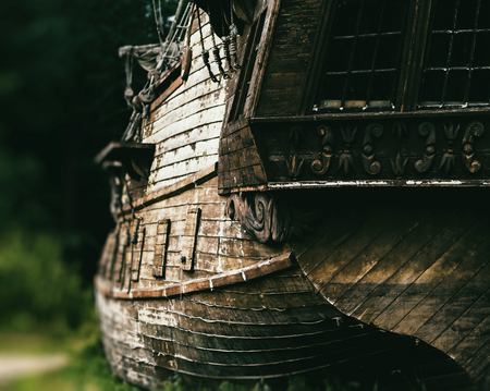 Horizontal vintage medieval warship on land background backdrop Stock Photo