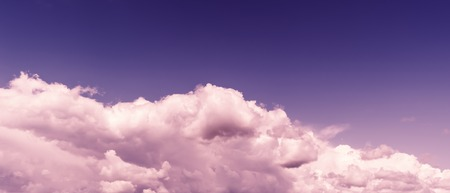 aligned: Horizontal vivid purple tinted  wide pano bottom aligned cloudscape design element background backdrop Stock Photo