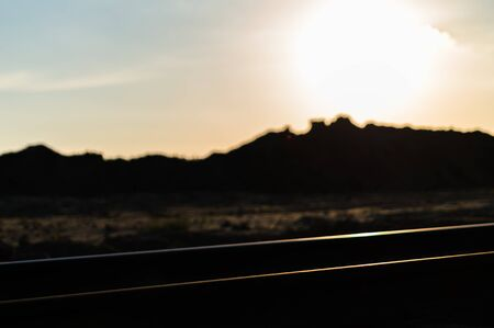 railroad track: Horizontal vivid colourful railroad track sunset bokeh background backdrop