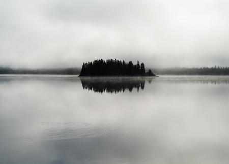 centered: Norway centered island fog lake