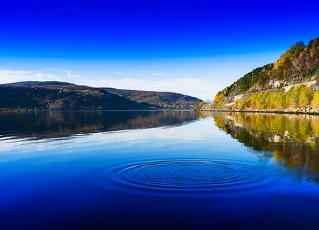 Horizontal vivid Norway day river water circles drops background backdrop Stock Photo