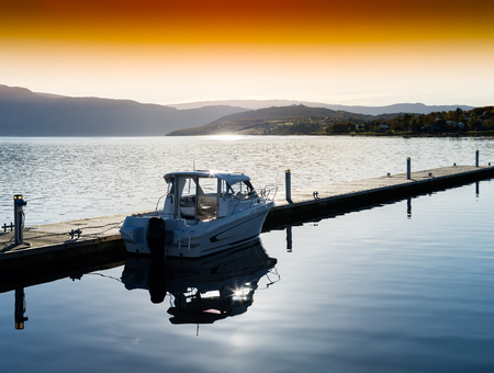 Horizontal sunset Norway boat near pier landscape background Stock Photo