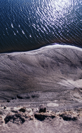 steep: Vertical vibrant sand steep ocean beach background backdrop