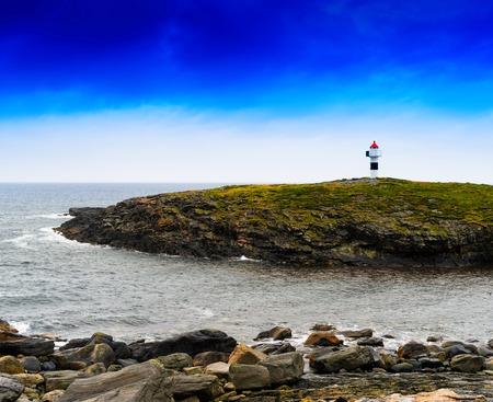 Horizontal vivid Norway right aligned lighthouse  on island landscape background backdrop Stock Photo
